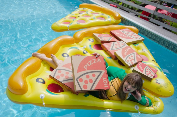Lauren Uchalik on a floating pizza